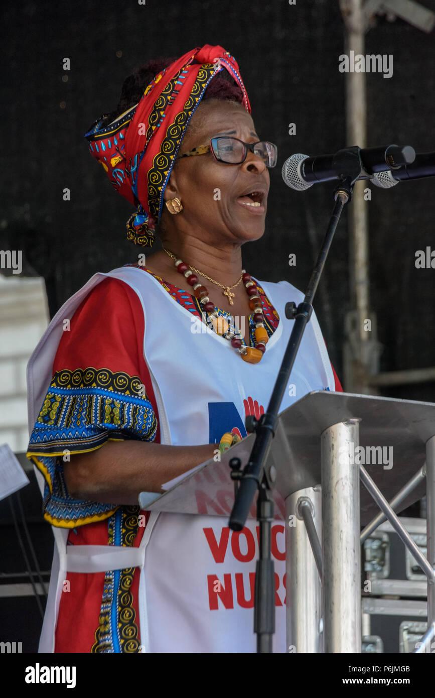 June 30, 2018 - London, UK. 30th June 2018. Royal College of Nursing (RCN) President Cecilia Anim speaks at the rally near Downing St to celebrate 70 years of the NHS, and to support its dedicated workers in demanding a publicly owned NHS that is free for all with proper funding and proper staffing and providing a world class services for every community. The protest, organised by the the People's Assembly, Health Campaigns Together, Trades Union Congress, Unison, Unite, GMB, British Medical Association, Royal College of Nursing, Royal College of Midwives, CSP, BDA, and SoR was to defend the - Stock Image