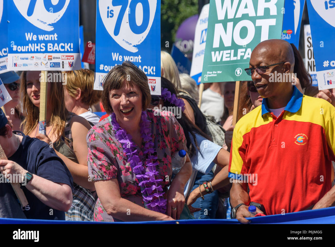 June 30, 2018 - London, UK. 30th June 2018. Frances O'Grady, TUC, General Secretary holds the main banner as the march through London from the BBC arrives at Downing St to celebrate 70 years of the NHS, and to support its dedicated workers in demanding a publicly owned NHS that is free for all with proper funding and proper staffing and providing a world class services for every community. The protest, organised by the the People's Assembly, Health Campaigns Together, Trades Union Congress, Unison, Unite, GMB, British Medical Association, Royal College of Nursing, Royal College of Midwives, - Stock Image