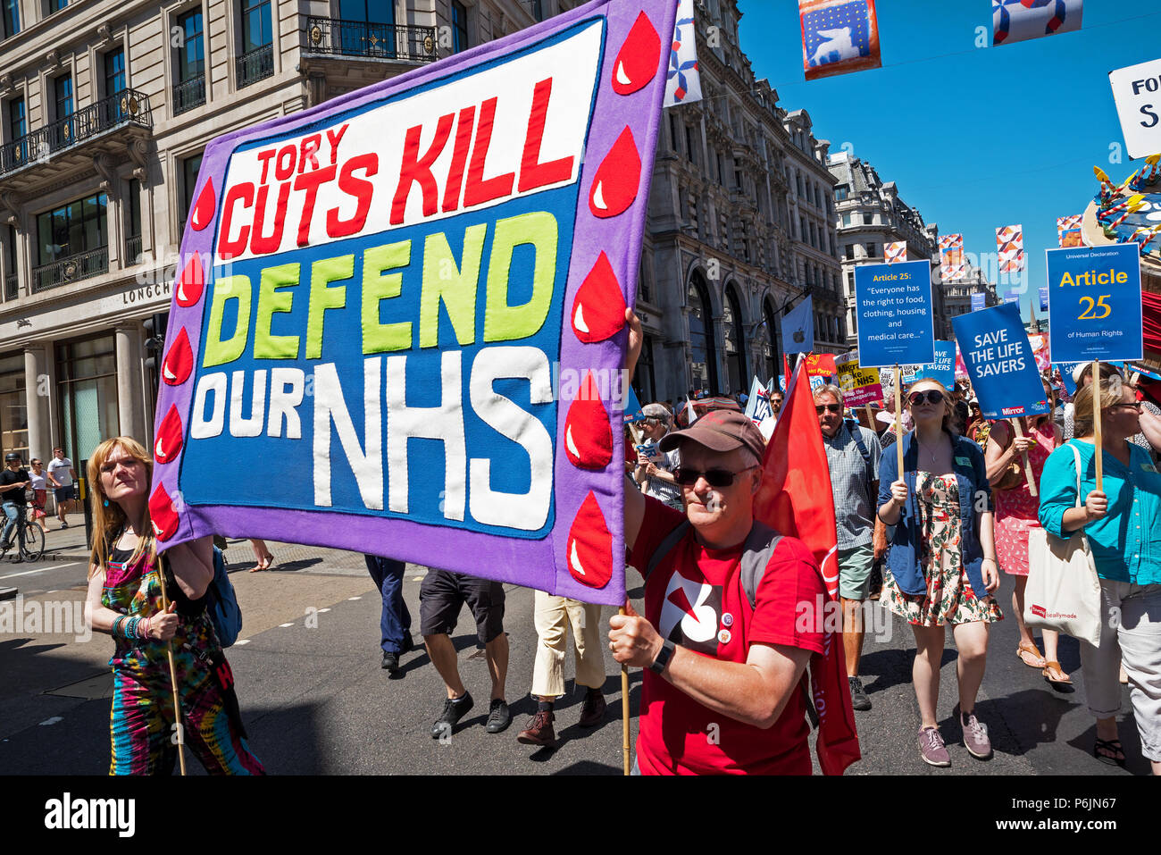 London, UK. 30th June 2018. NHS 70 march on Downing Street. Tens of thousands gathered by the BBC at Portland Place and marched through central London to mark the 70th anniversary of the National Health Service. They were campaigning for an end to cuts, privatisation, and for credible funding. The march and rally was organised by the People's Assembly Against Austerity, Health Campaigns Together, TUC and health service trade unions. Credit: Stephen Bell/Alamy Live News. - Stock Image