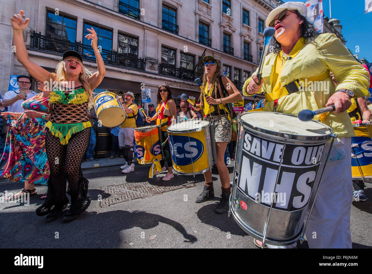 London, UK. 30th Jun, 2018. #OurNHS70: free, for all, forever a protest and celebration march in honour of the 70 year history of the National Health Service. Organised by: The People's Assembly, Trades Union Congress, Unison, Unite, GMB, British Medical Association, Royal College of Nursing, Royal College of Midwives amongst others. Credit: Guy Bell/Alamy Live News - Stock Image