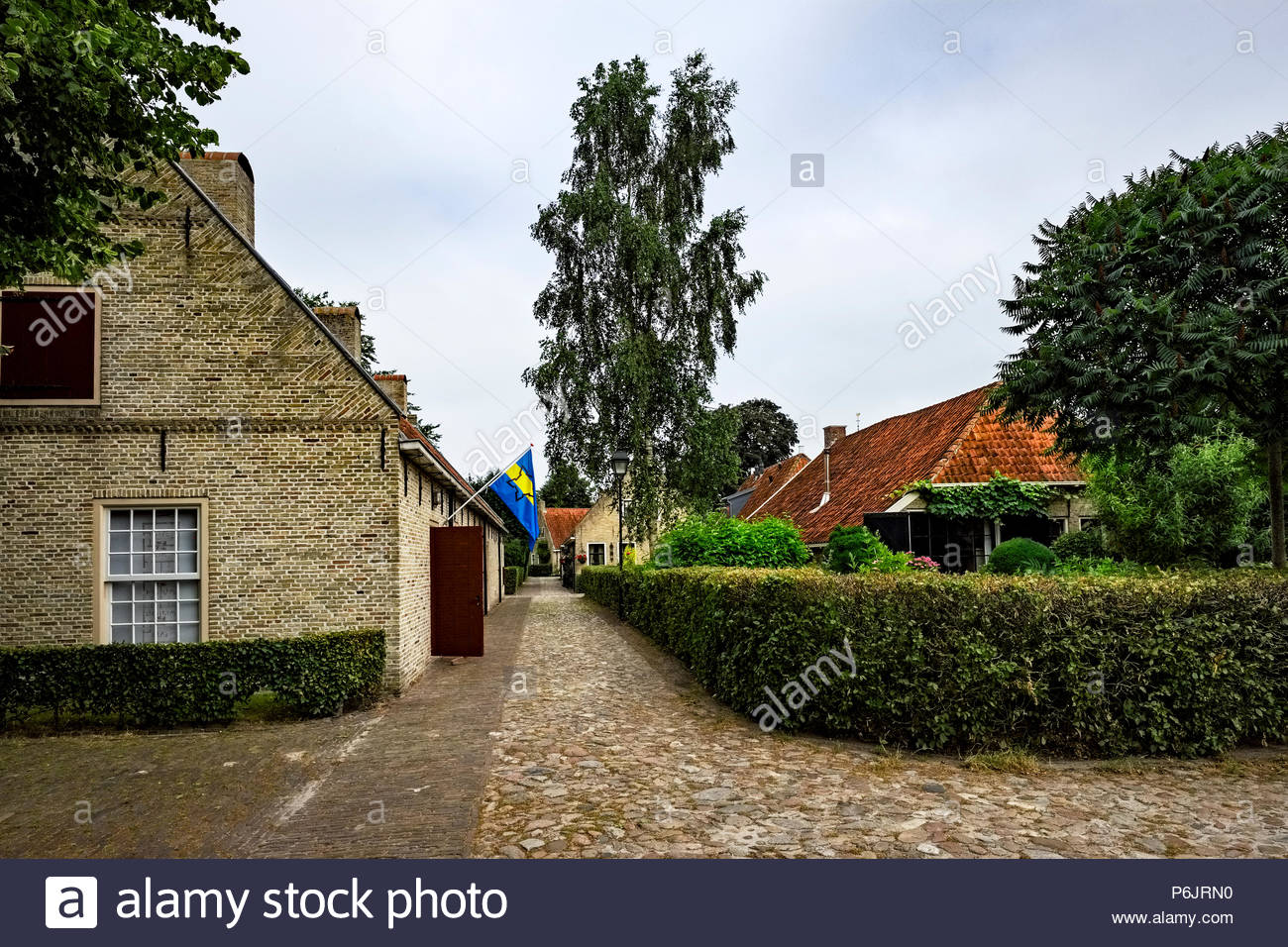 Buildings and cobblestone walkway at Vesting Bourtange, the star-shaped fortress in Groningen Province, The Netherlands - Stock Image