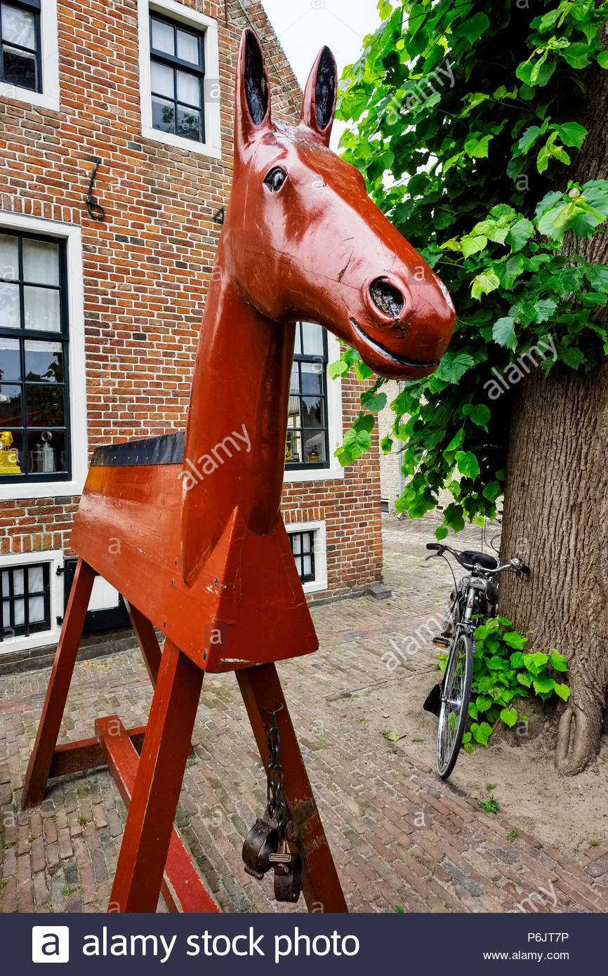 Wooden horse with shackles was used as a form of punishment by public humiliation and, no doubt, a sore bottom. - Stock Image
