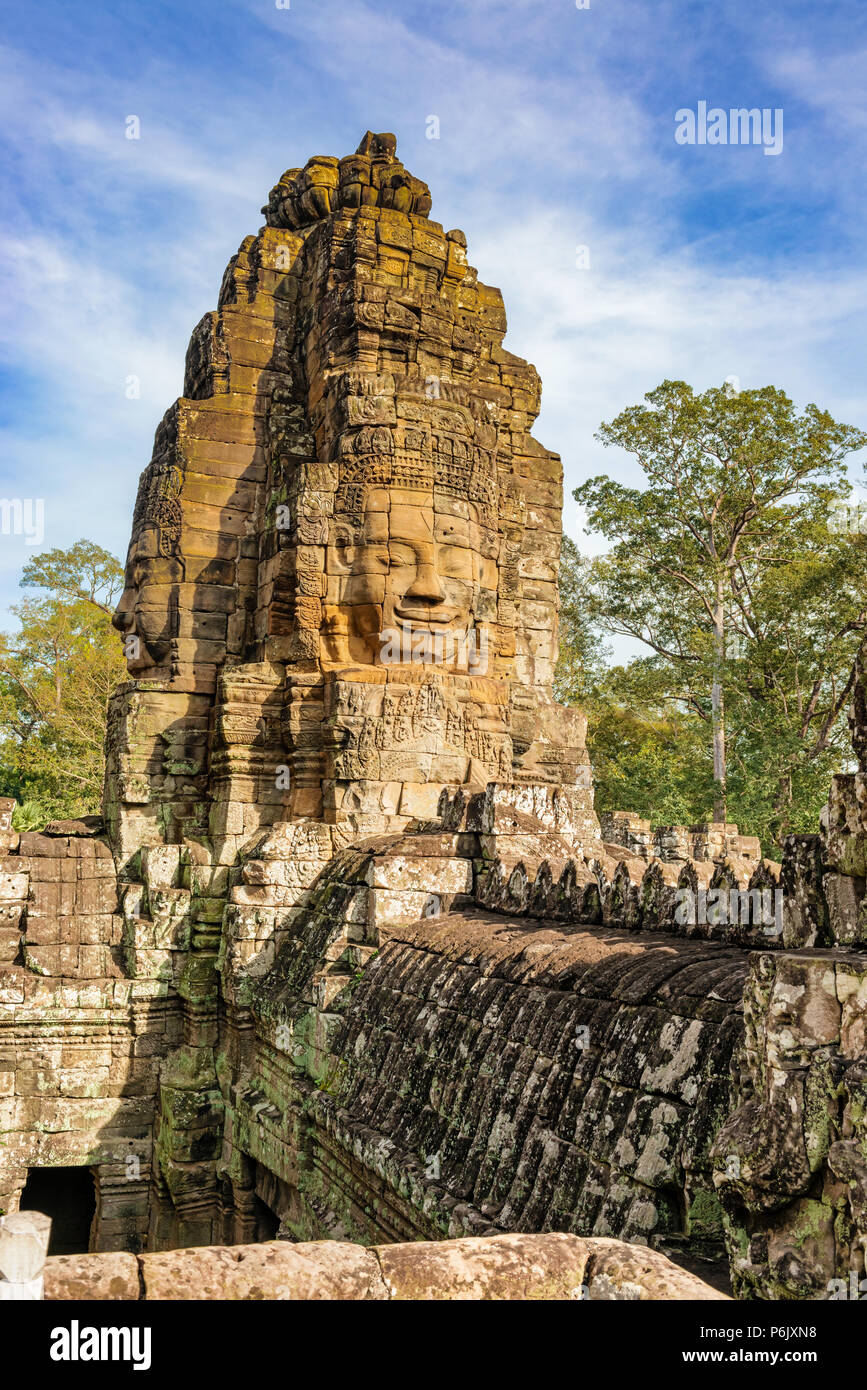 Bayon is richly decorated Khmer temple at Angkor in Cambodia. Built in 12th century as official state temple of Mahayana Buddhist King. It stands at t - Stock Image