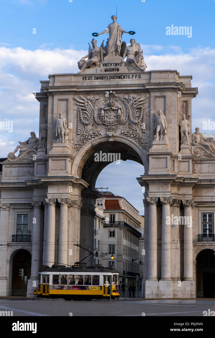 Rua Augusta Arch in Lisbon with iconic yellow trolley passing out front. - Stock Image