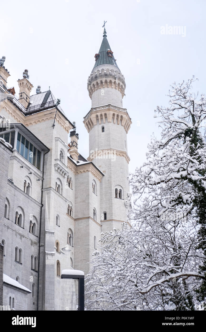 Neuschwanstein Castle in winter landscape. a nineteenth-century Romanesque Revival palace on a rugged hill above the village of Hohenschwangau near Fü - Stock Image