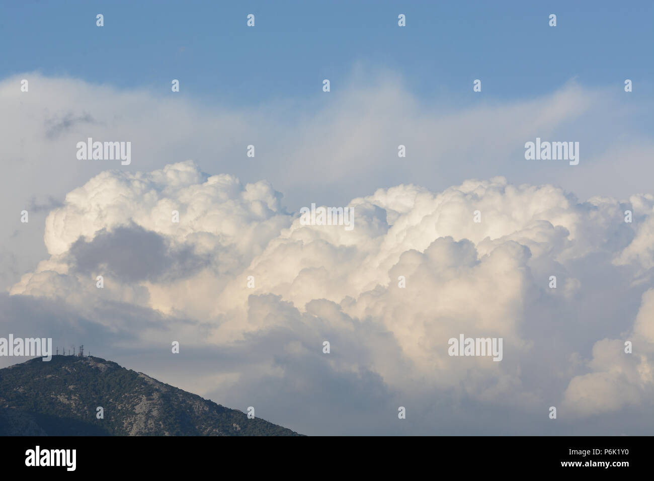 Majesty cumulonimbus indicating that in the distance a storm is underway with very high rainfall rates - Stock Image