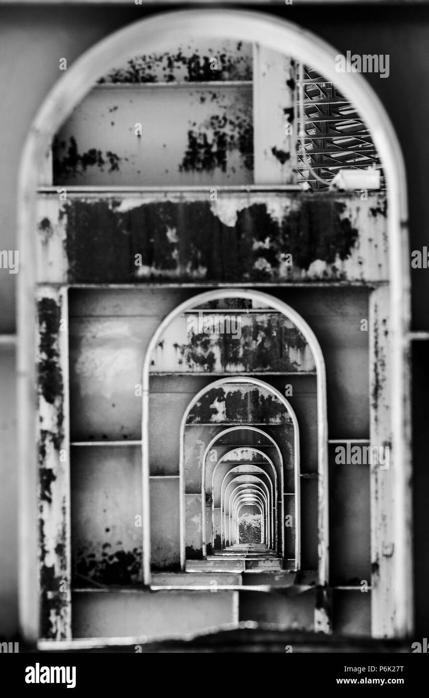 Concentric arches in a factory structure - Stock Image