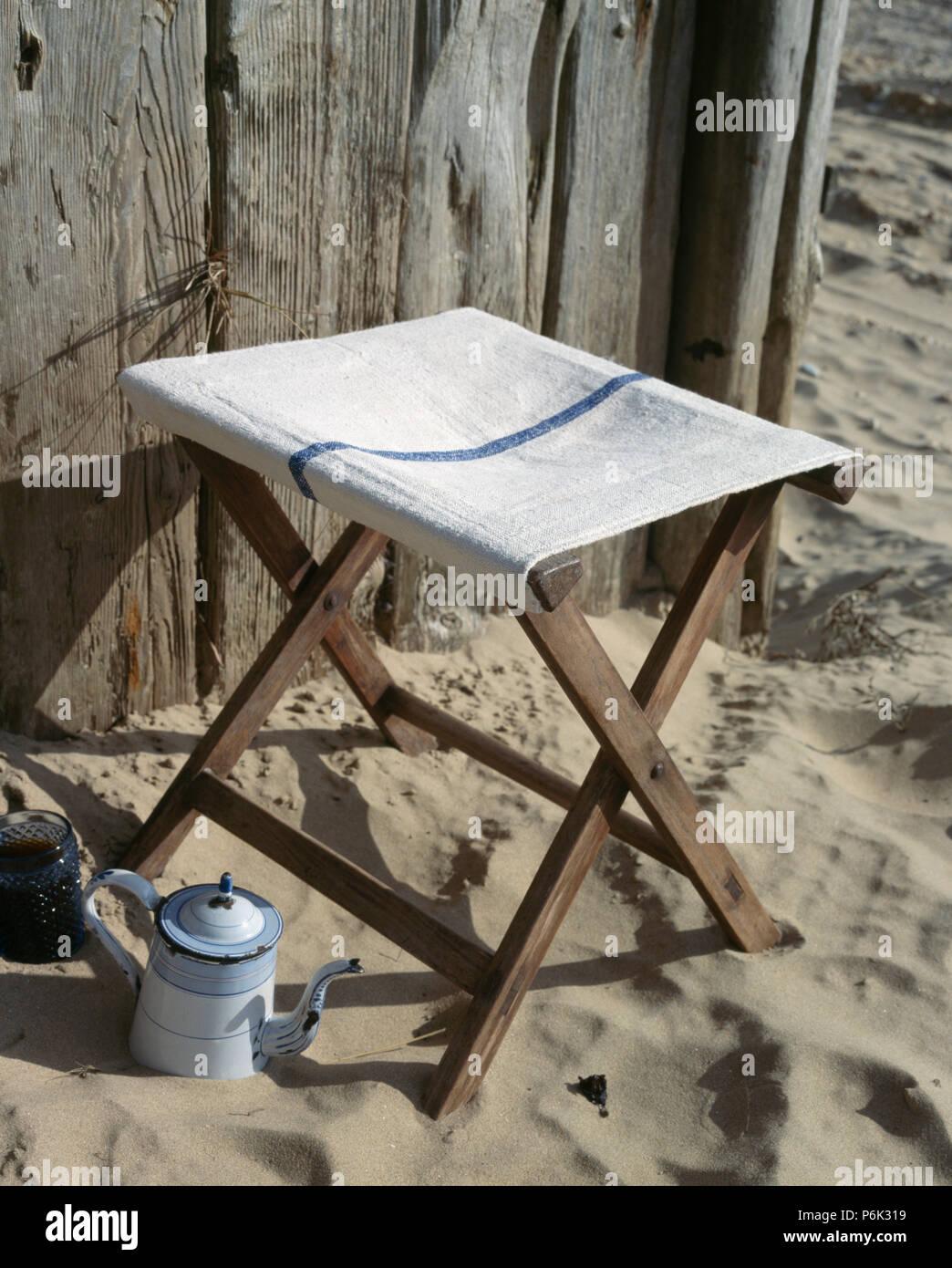 Tremendous Enamel Coffeepot On Sand Beside Canvas And Wood Folding Camellatalisay Diy Chair Ideas Camellatalisaycom