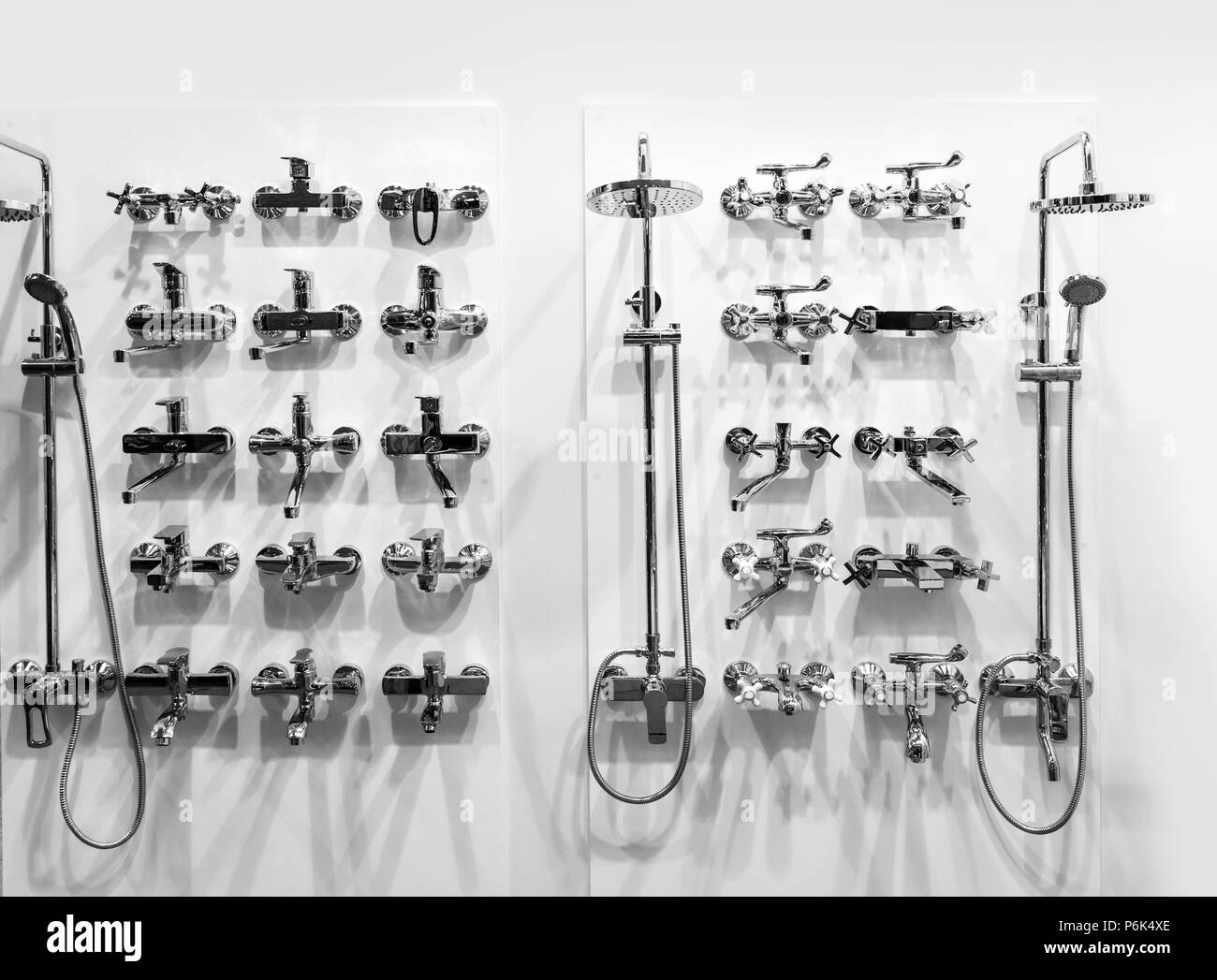 New chrome showers and faucets in plumbing shop, closeup, nobody ...