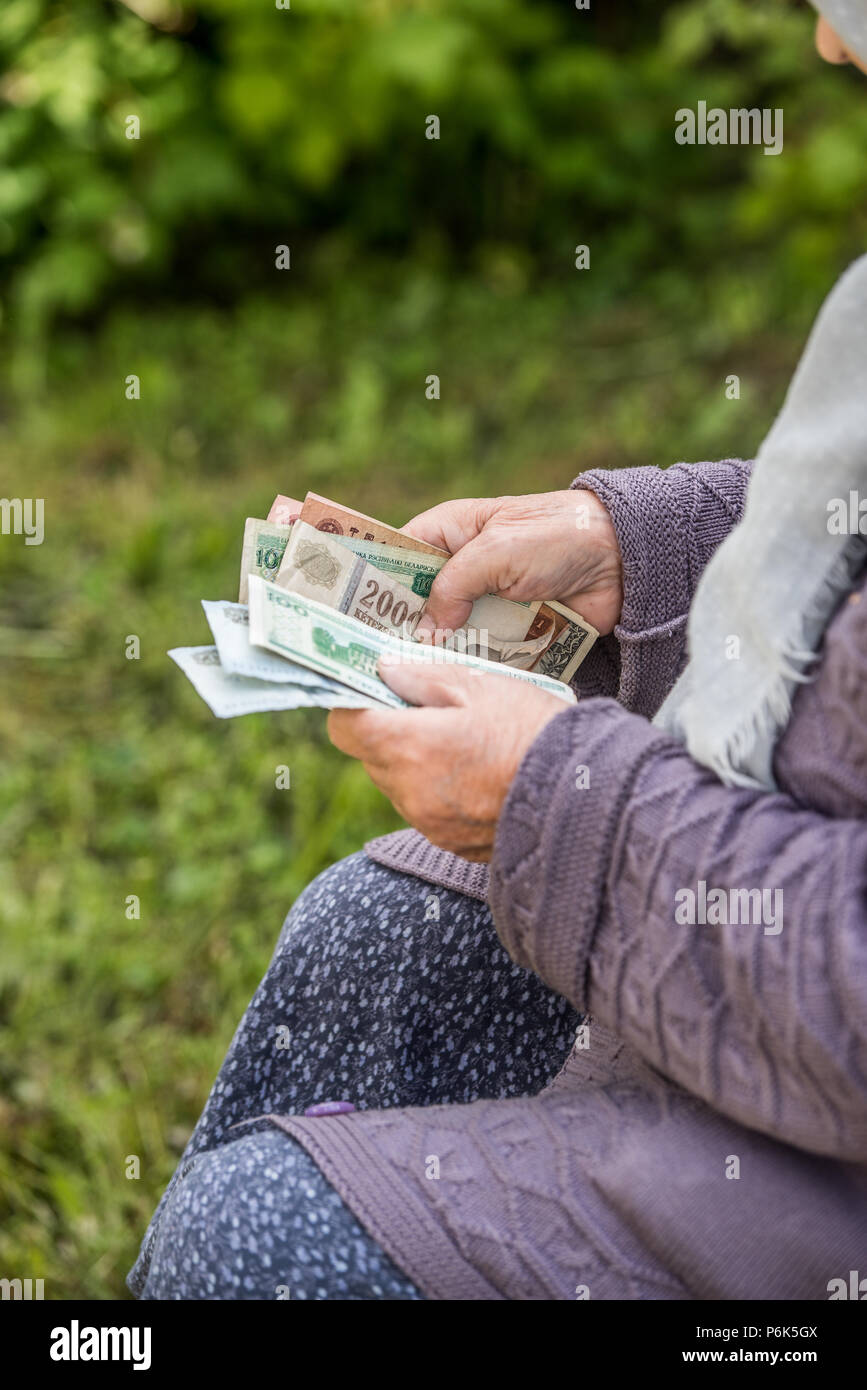 The old woman considers banknotes - hands and money close up Stock Photo