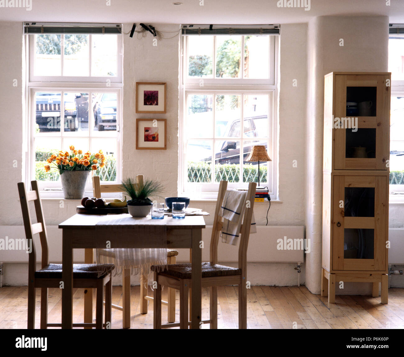 simple wooden dining table and chairs in an economy style dining rh alamy com