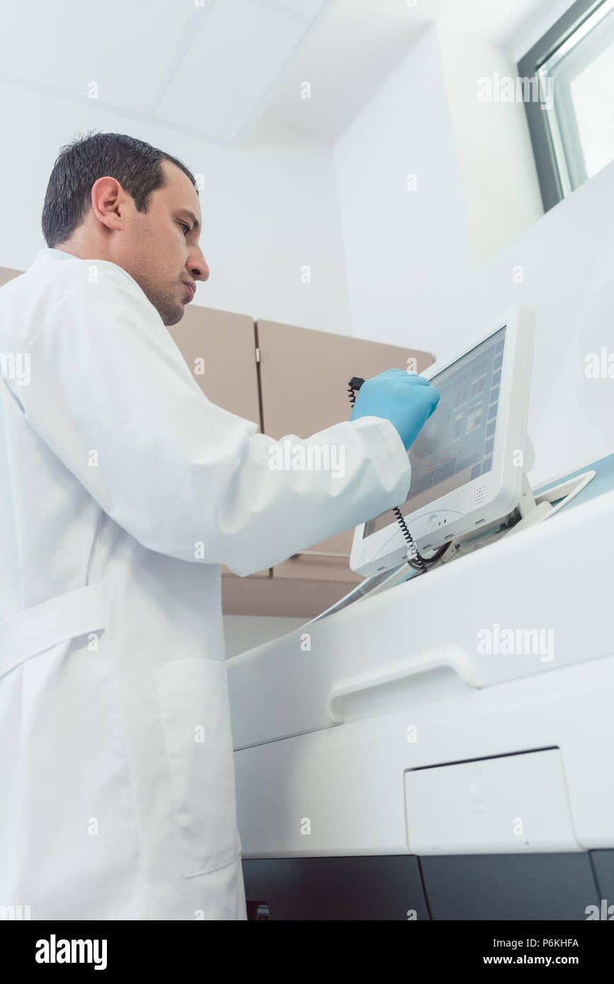 Doctor preparing a blood count in the laboratory - Stock Image
