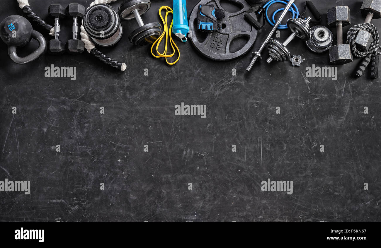 Sports equipment on a black background. Top view. Motivation. Copy space. - Stock Image