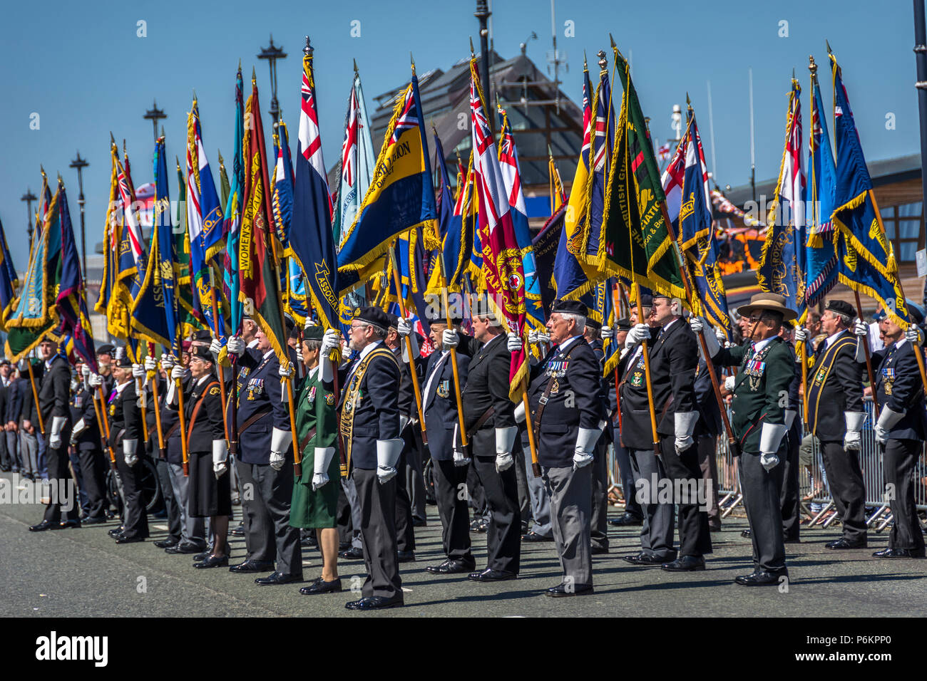 Armed Forces Day 2018 in Llandudno. UK Veterans holding flags on parade. 2018 on a very hot day. - Stock Image
