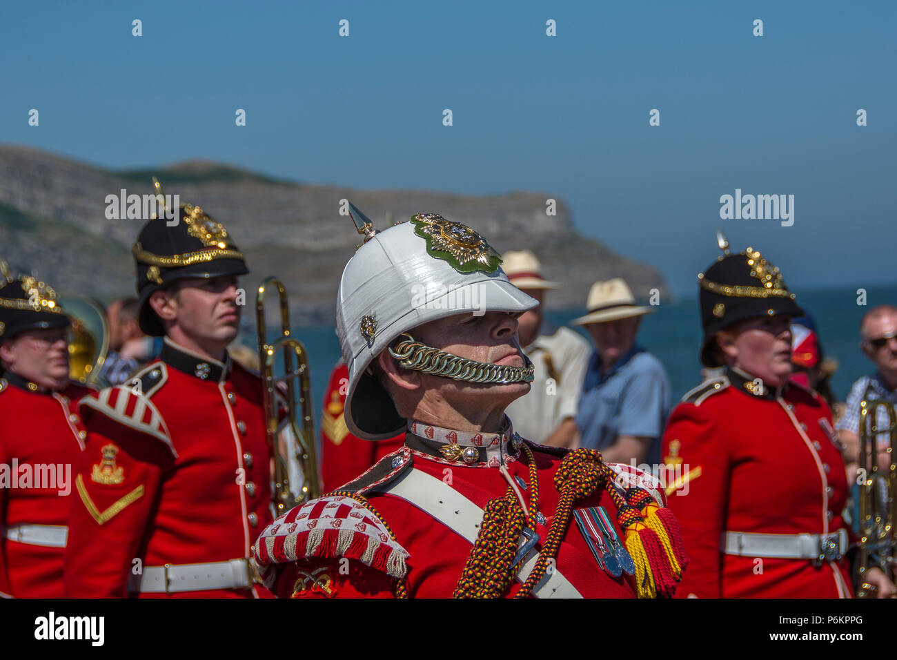 Armed Forces Day 2018 in Llandudno. Marching solders in red uniforms. A very hot day. soldiers sweating in uniform. - Stock Image