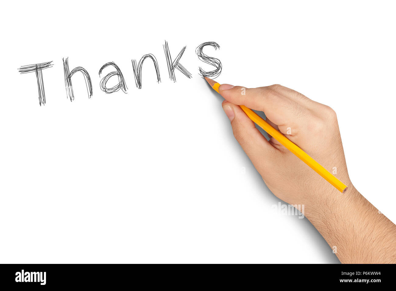 Hand writing Thanks with pencil on white - Stock Image