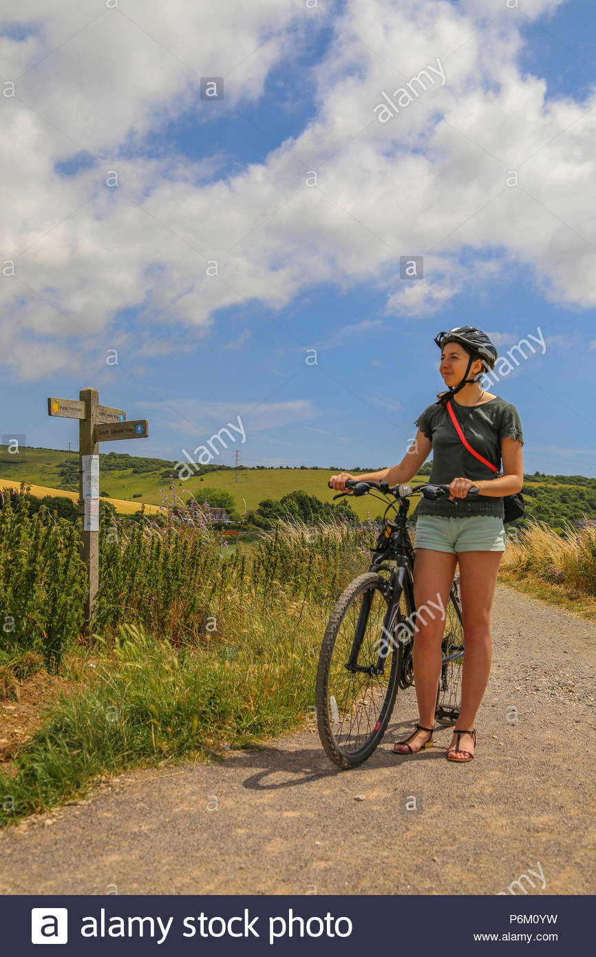 Female cyclist exploring the South Downs National Park on a summer day, United Kingdom - Stock Image