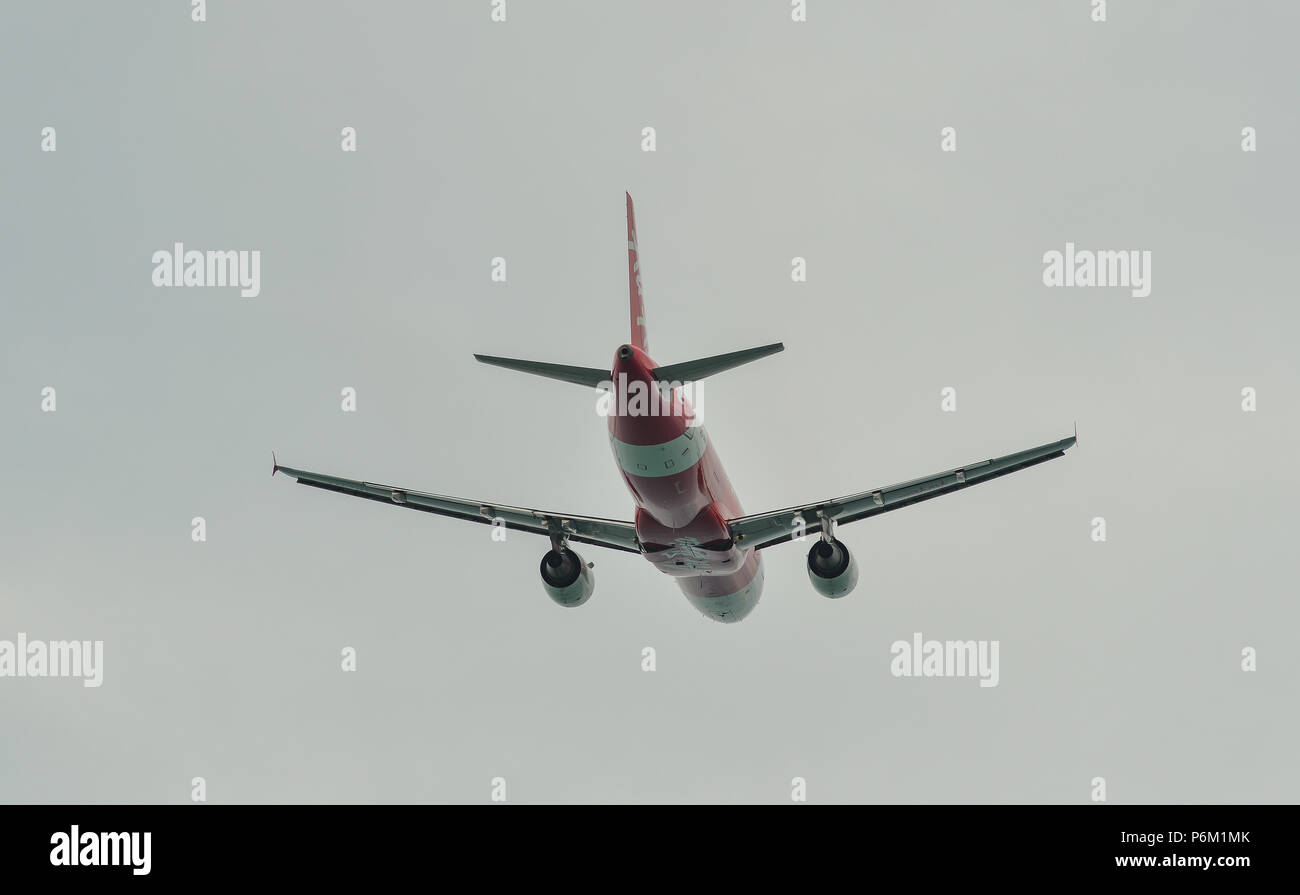 Phuket, Thailand - Apr 23, 2018. An Airbus A320 airplane of AirAsia taking-off from Phuket International Airport (HKT). Stock Photo