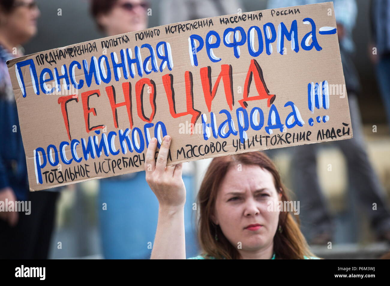 Omsk, Russia. 01st July, 2018. OMSK, RUSSIA - JULY 1, 2018: A woman takes part in a protest against a draft law proposed by the Russian government to raise the retirement age for men from 60 to 65 years old and for women from 55 to 63 years old. Dmitry Feoktistov/TASS Credit: ITAR-TASS News Agency/Alamy Live News - Stock Image