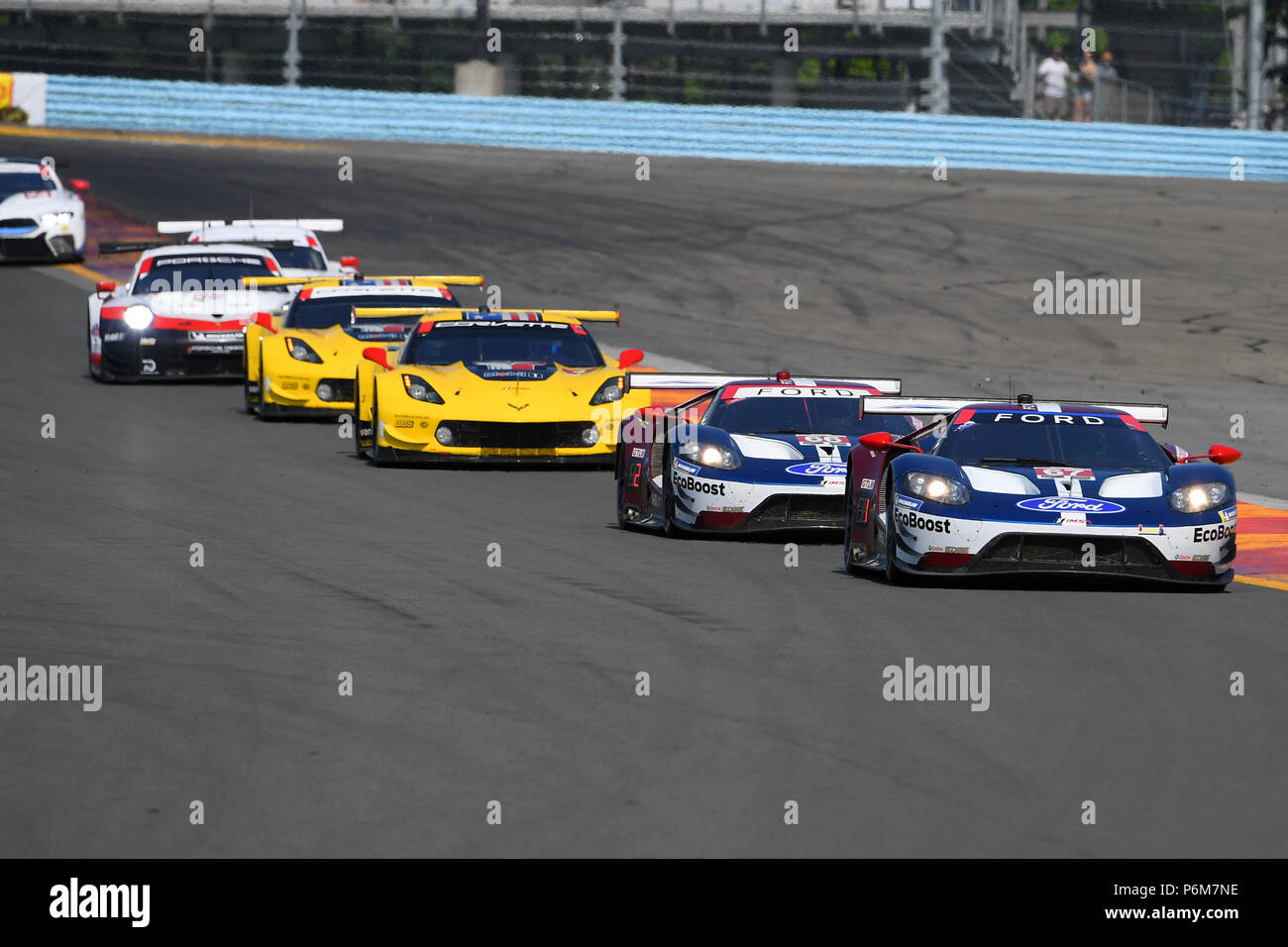 The  Ford Chip Ganassi Racing Ford Gt Driven By Ryan Briscoe Of Australia And Richard Westbrook Of Great Britain Leads A Group Of