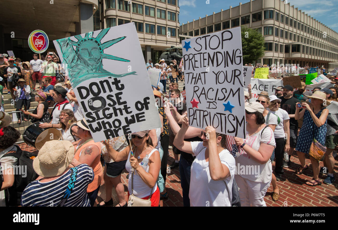Boston, Massachusetts, USA. 30th June, 2018.  U.S. Demonstrators holding a signs in City Hall Plaza in Boston, MA during the Rally against Family Separation by the current United States administration. Rallies against U.S. President Donald Trump's policy of the detention of Central American and Mexican immigrants and immigrant families separated by U.S. customs and border agents (I.C.E.) took place all over the United States.  Credit: Chuck Nacke/Alamy Live News Stock Photo