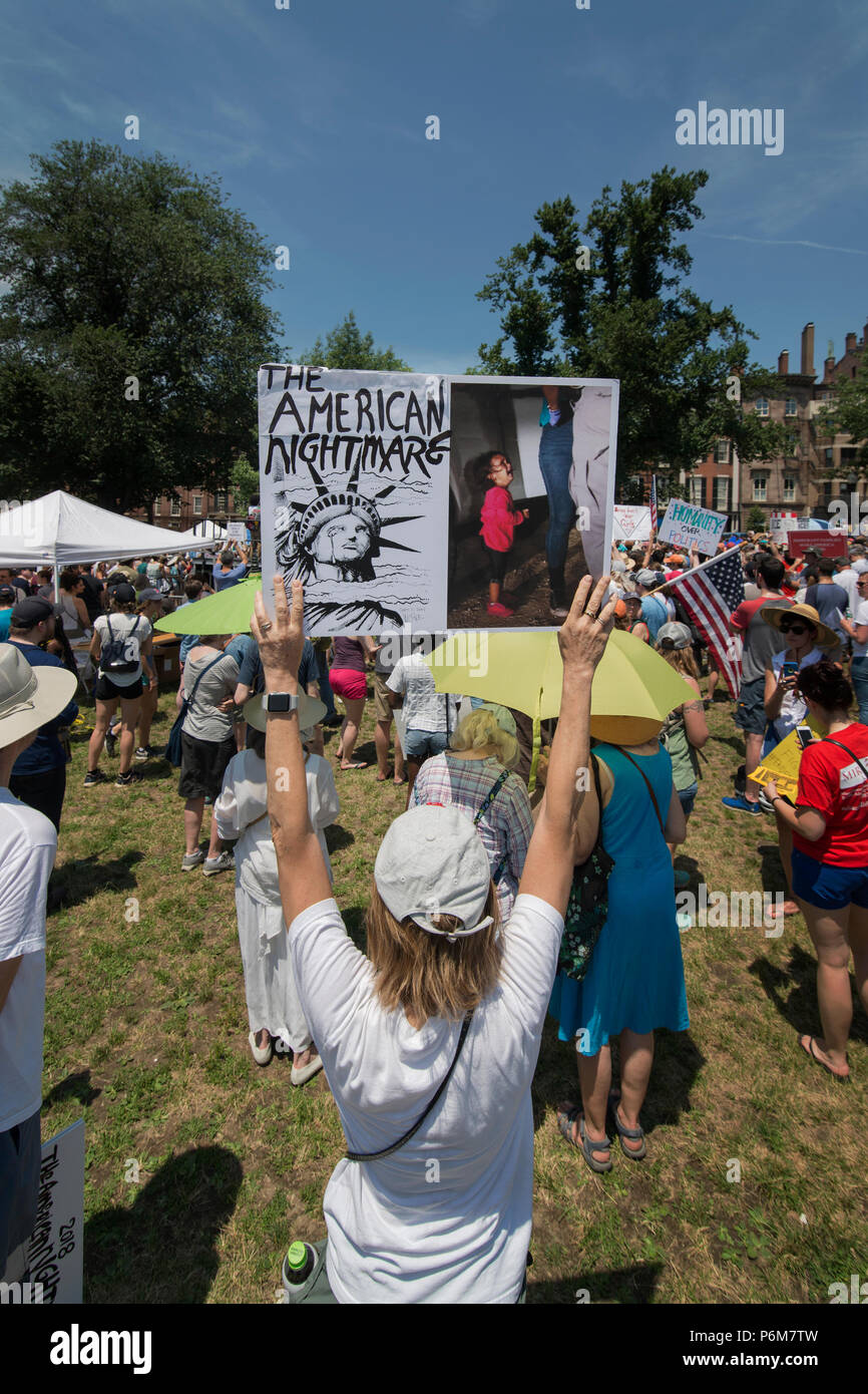 Boston, Massachusetts, USA. 30th June, 2018.  U.S. Demonstrator holding a sign as thousands gathered in the Boston Common in Boston, MA during the Rally against Family Separation by the current United States administration. Rallies against U.S. President Donald Trump's policy of the detention of immigrants and immigrant families separated by U.S. customs and border agents (I.C.E.) took place in more than 750 US cities on June 30th. Credit: Chuck Nacke/Alamy Live News - Stock Image