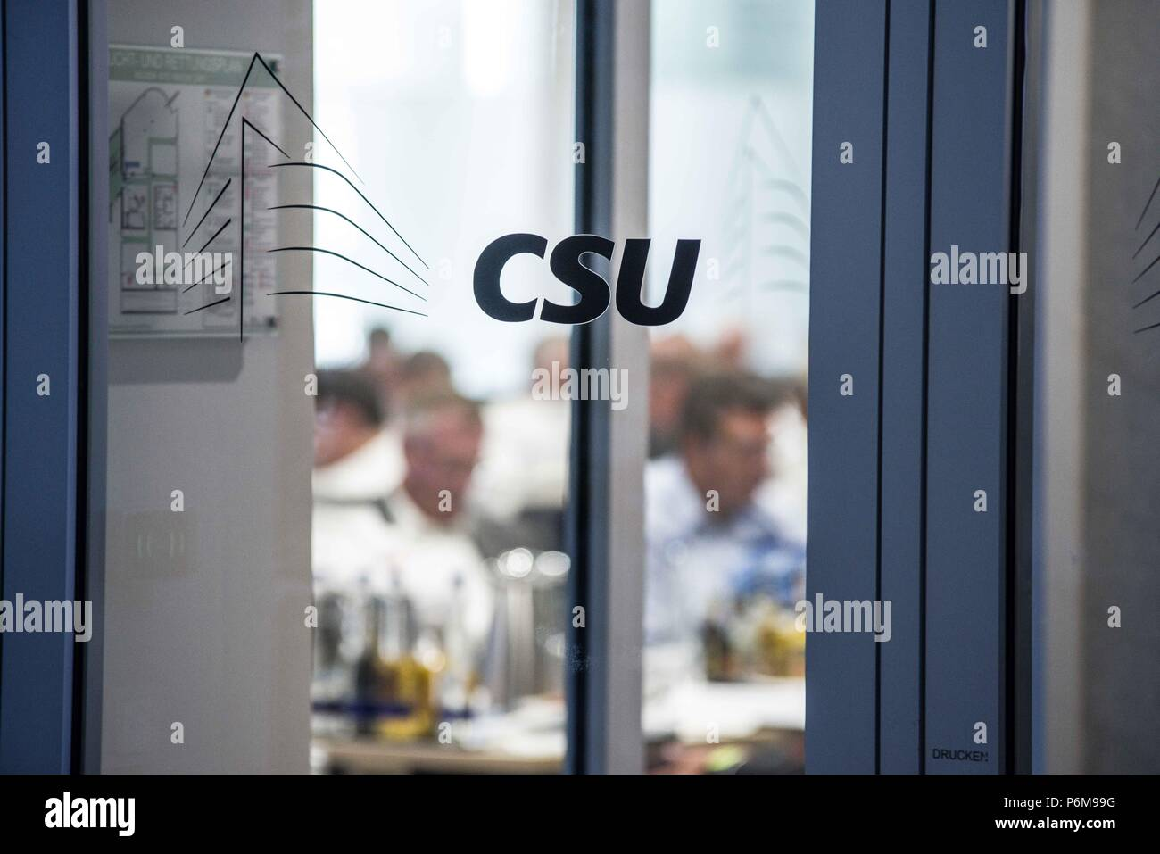 Munich, Bavaria, Germany. 1st July, 2018. Officials of the Bavarian CSU party hold a meeting to determine if the CSU will split from its union with Angela Merkel's CDU, effectively dissolving Germany's government, or if it will continue. The point of difference is regarding the sending of migrants back to the country of their first registration at the German border. Credit: Sachelle Babbar/ZUMA Wire/Alamy Live News - Stock Image