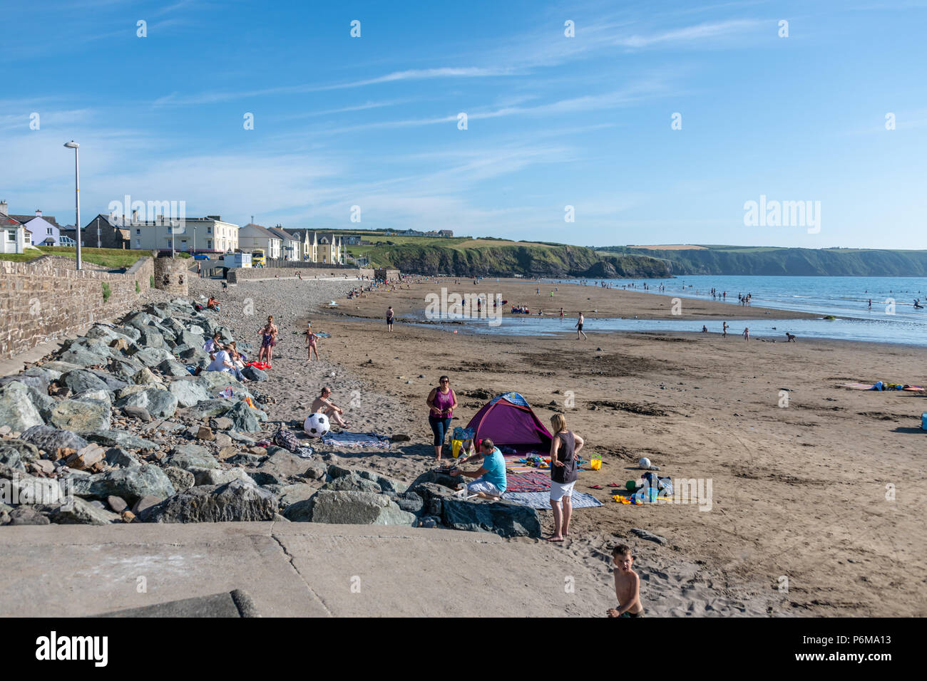 Broad Haven, Wales, UK. 30th June 2018. People enjoy the last of the June heatwave on the beach at Broad Haven and Littlehaven in South Wales. Credit Thomas Faull / Alamy Live News Stock Photo