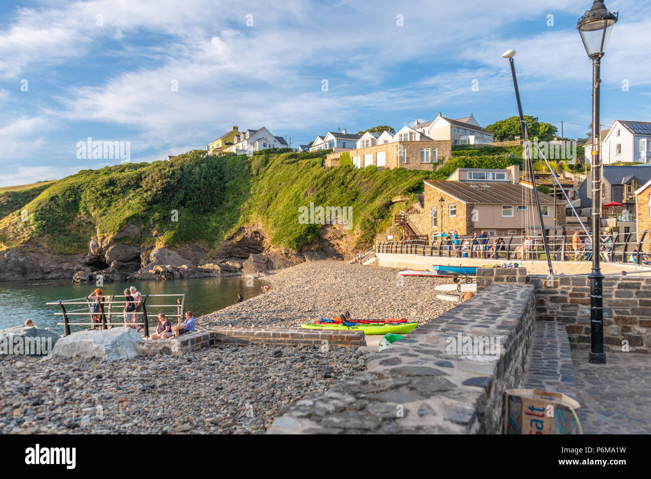 Broad Haven, Wales, UK. 30th June 2018. People enjoy the last of the June heatwave on the beach at Little Haven in South Wales. Credit Thomas Faull / Alamy Live News Stock Photo
