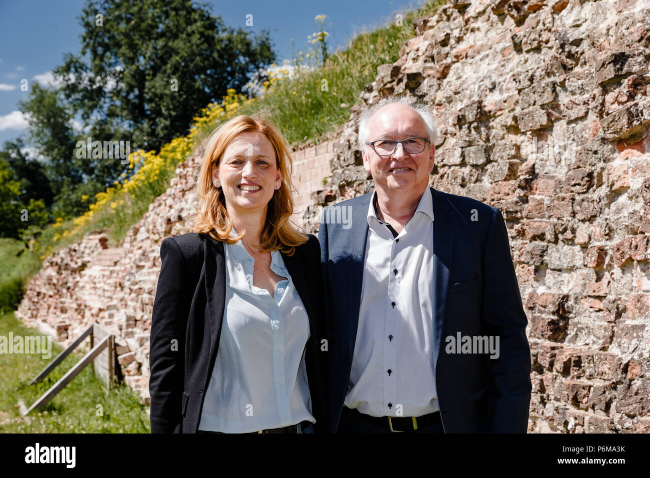 01 July 2018, Germany: Karin Prien (CDU), culture minister of Schleswig-Holstein; and Jon Hardon Hansen, chairman of the Sydslesvigsk Forening (SSV) organisation, standing in front of the Danevirke fortification. Danevirke was entered into the UNESCO World Heritage List, along with the Haitabu Viking site, on 30 June 2018. Photo: Markus Scholz/dpa - Stock Image