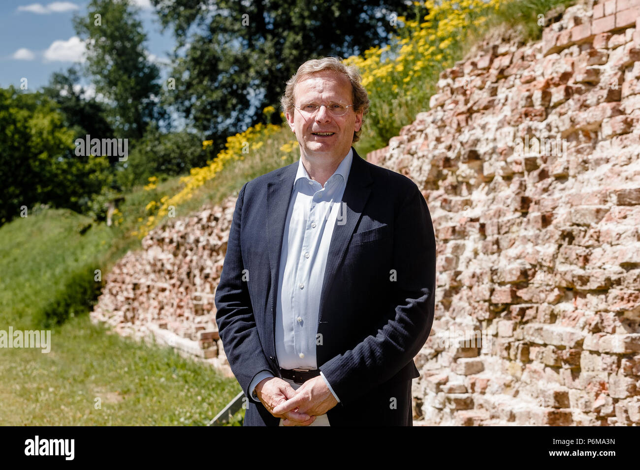 01 July 2018, Germany: Claus von Carnap-Bornheim, managing director of the Stiftung Schleswig-Holsteinischer Landesmuseen (Foundation of Schleswig-Holstein State Museums), standing in front of the Danevirke fortification. Danevirke was entered into the UNESCO World Heritage List, along with the Haitabu Viking site, on 30 June 2018. Photo: Markus Scholz/dpa - Stock Image