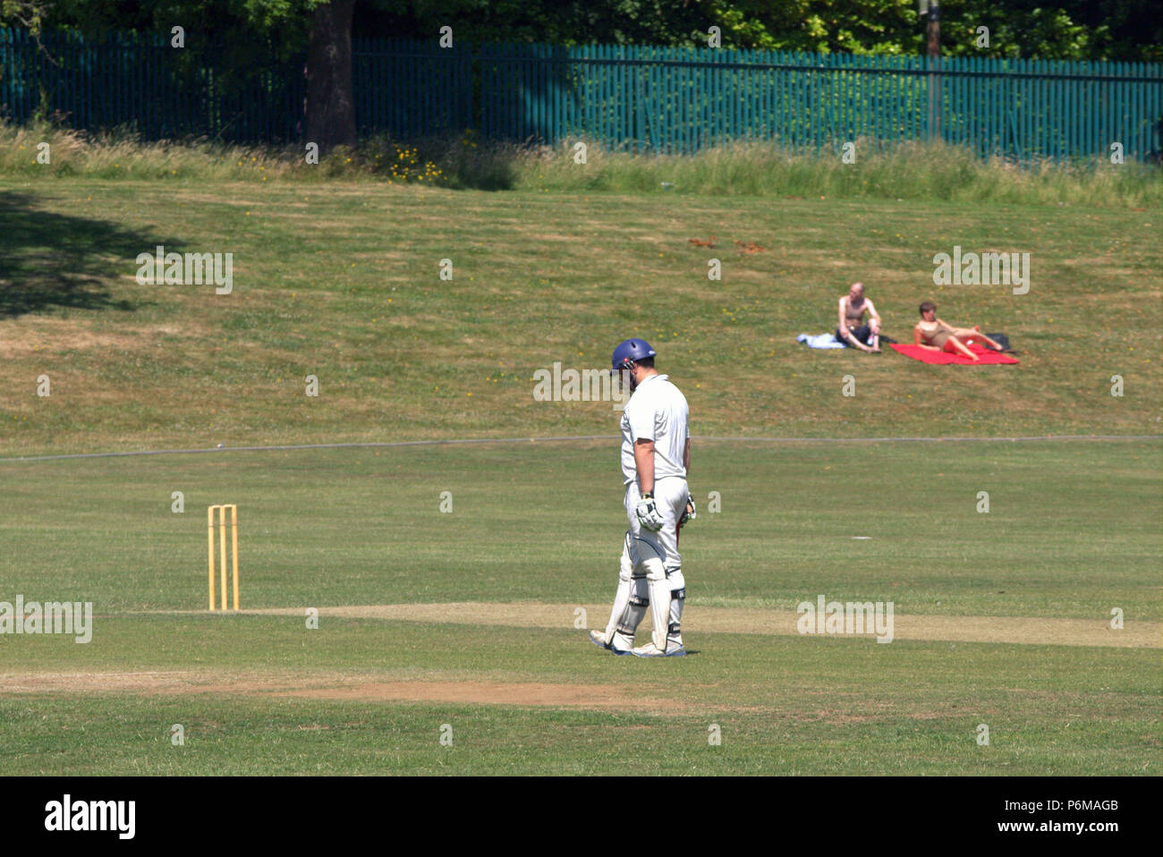 Glasgow, Scotland, UK 1st July. UK Weather:Sunny sizzling weather continues and locals and tourists in the city .Sunday league cricket in Partick saw Prestwick and west of Scotland enjoy the sun.. Credit: gerard ferry/Alamy Live News Stock Photo
