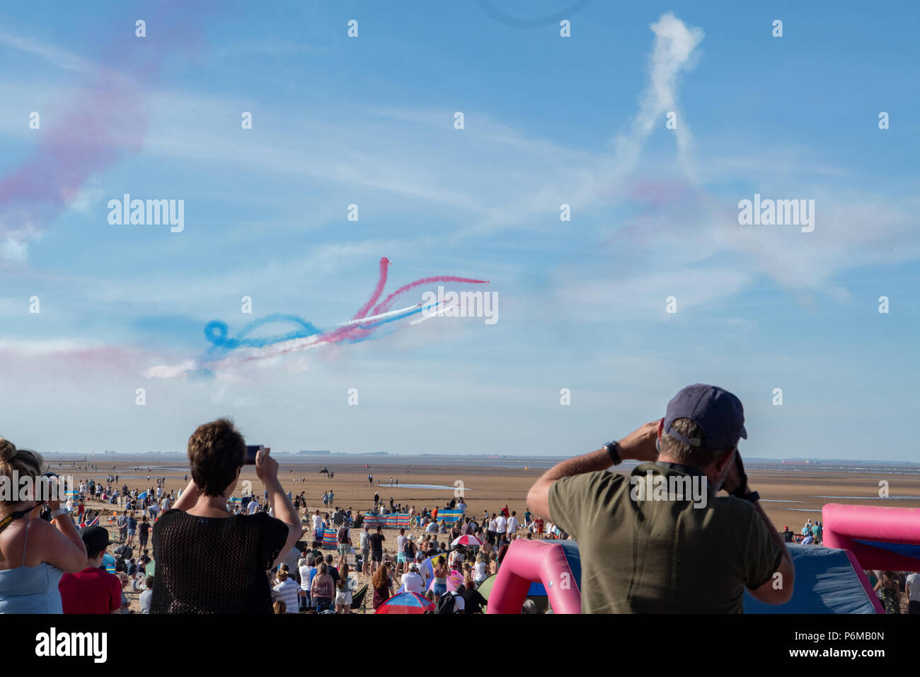 Cleethorpes beach, UK. 1st Jul, 2018. Armed response police patrol the crowds with loaded assault rifles at Armed Forces Day on Cleethorpes beach as thirty thousand tourists turn out in 28 degree heat to watch the air displays and military parades. Credit: Steve Thornton/Alamy Live News - Stock Image