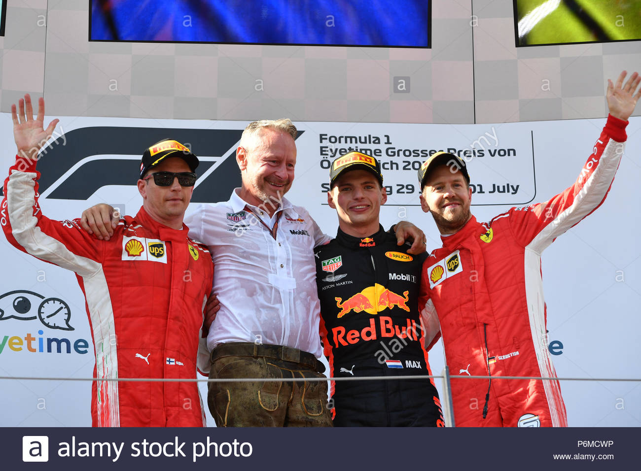 Red Bull Ring, Spielberg, Austria. 1st Jul, 2018. Kimi Raikkonen (FIN) Ferrari, Jonathan Wheatley (GBR) Red Bull Racing Team Manager, mxp and Sebastian Vettel (GER) Ferrari celebrate on the podium during the Austrian GP at Red Bull Ring on July 01, 2018 in Red Bull Ring, Austria. (Photo by Mark Sutton / Sutton Images) Credit: Motorsport Images/Alamy Live News - Stock Image