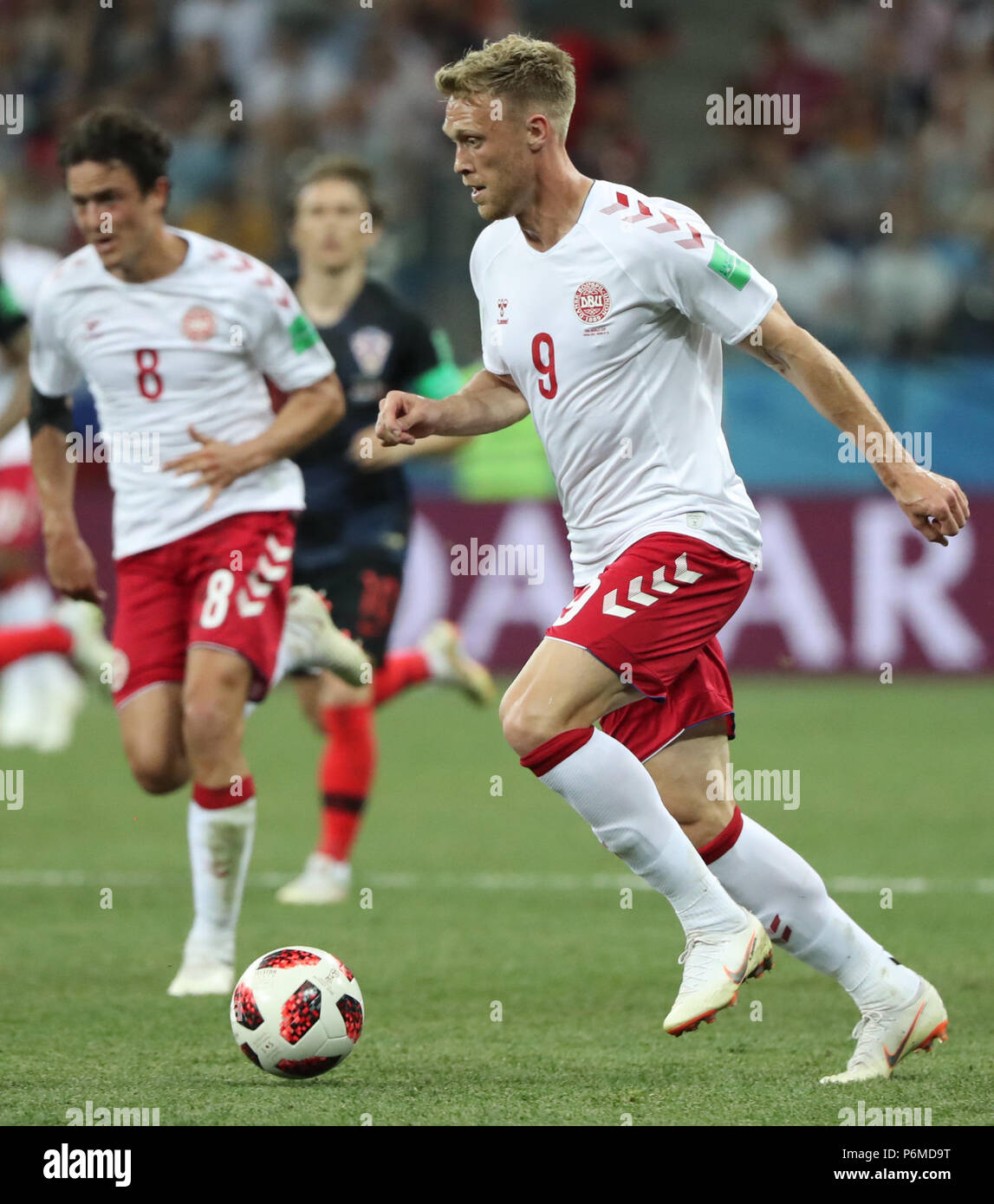 Nizhny Novgorod, Russia. 1st July, 2018. Nicolai Jorgensen (R) of Denmark competes during the 2018 FIFA World Cup round of 16 match between Croatia and Denmark in Nizhny Novgorod, Russia, July 1, 2018. Credit: Bai Xueqi/Xinhua/Alamy Live News - Stock Image