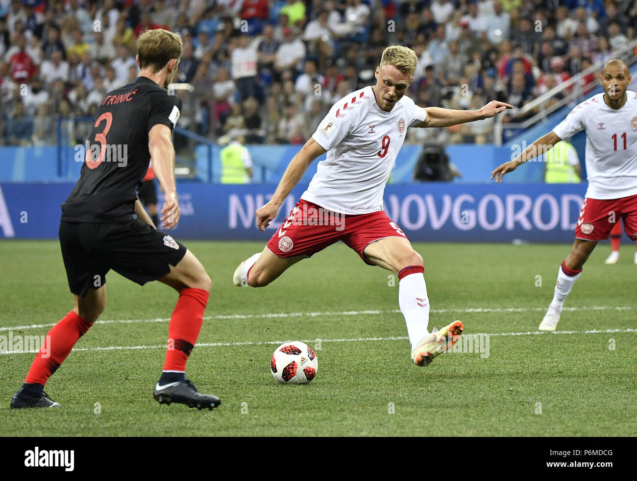 Nizhny Novgorod, Russia. 1st July, 2018. Nicolai Jorgensen (C) of Denmark shoots during the 2018 FIFA World Cup round of 16 match between Croatia and Denmark in Nizhny Novgorod, Russia, July 1, 2018. Credit: He Canling/Xinhua/Alamy Live News - Stock Image