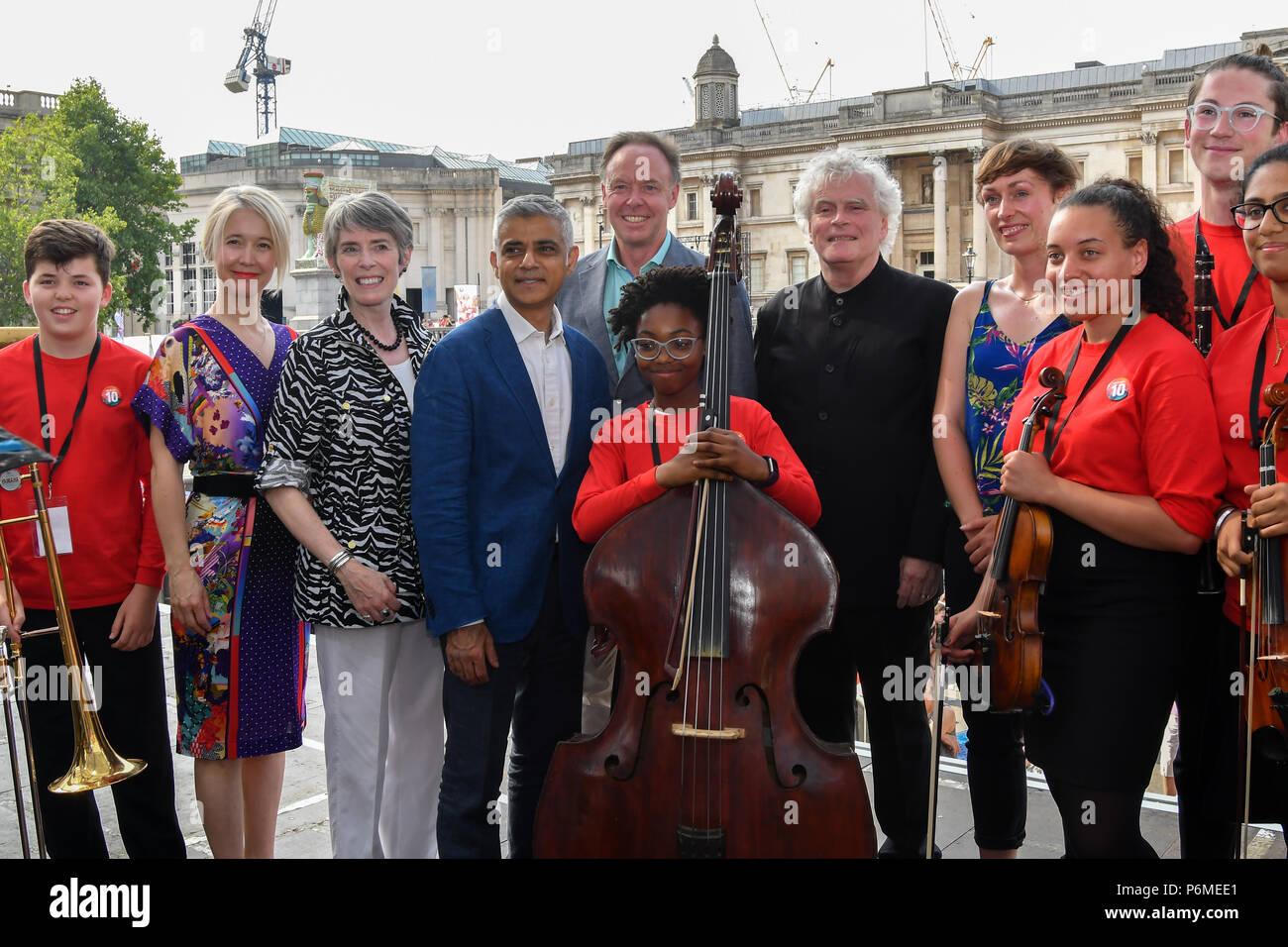 London, UK. 1st July, 2018. Photocall of Sadiq Khan,Sir Simon Rattle, Ian Robertson,Kathryn McDowell,KATE WHITLEY at the BMW Classics + live streamed on YouTube in Trafalgar Square on a hot weather in London, UK on July 1st 2018. Credit: Picture Capital/Alamy Live News - Stock Image