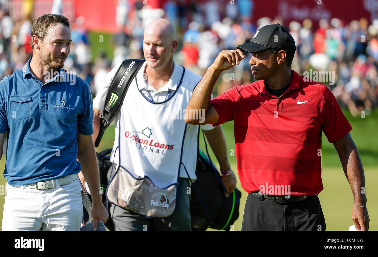 a744920b Potomac, MD, USA. 1st July, 2018. Tiger Woods talks with Bronson Burgoon as  they finish their ...