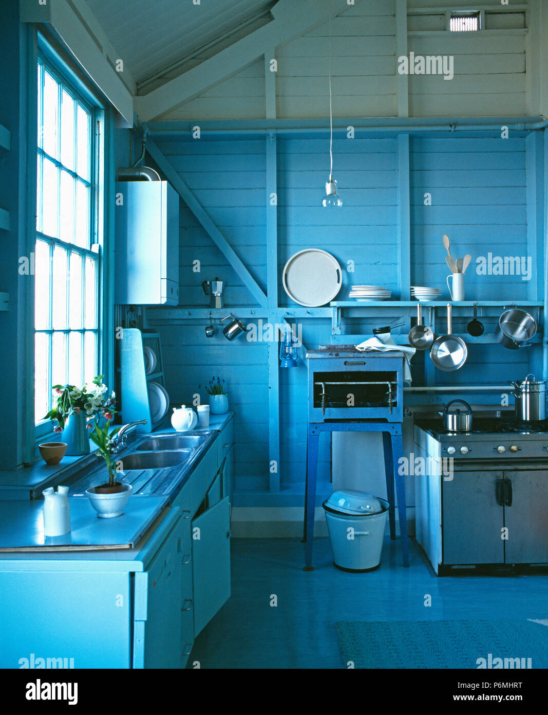 White enamel bucket beside range oven in country kitchen with ...