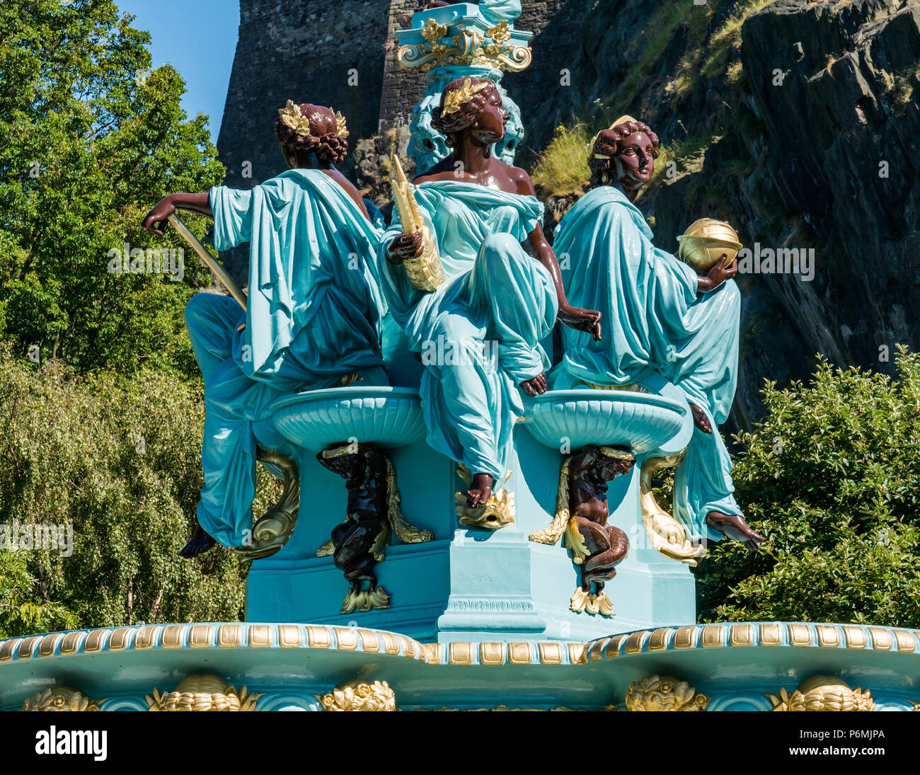 Victorian cast iron Ross fountain, restored and brightly painted in blue and gold with robed maidens, Princes Street Gardens, Edinburgh, Scotland, UK - Stock Image