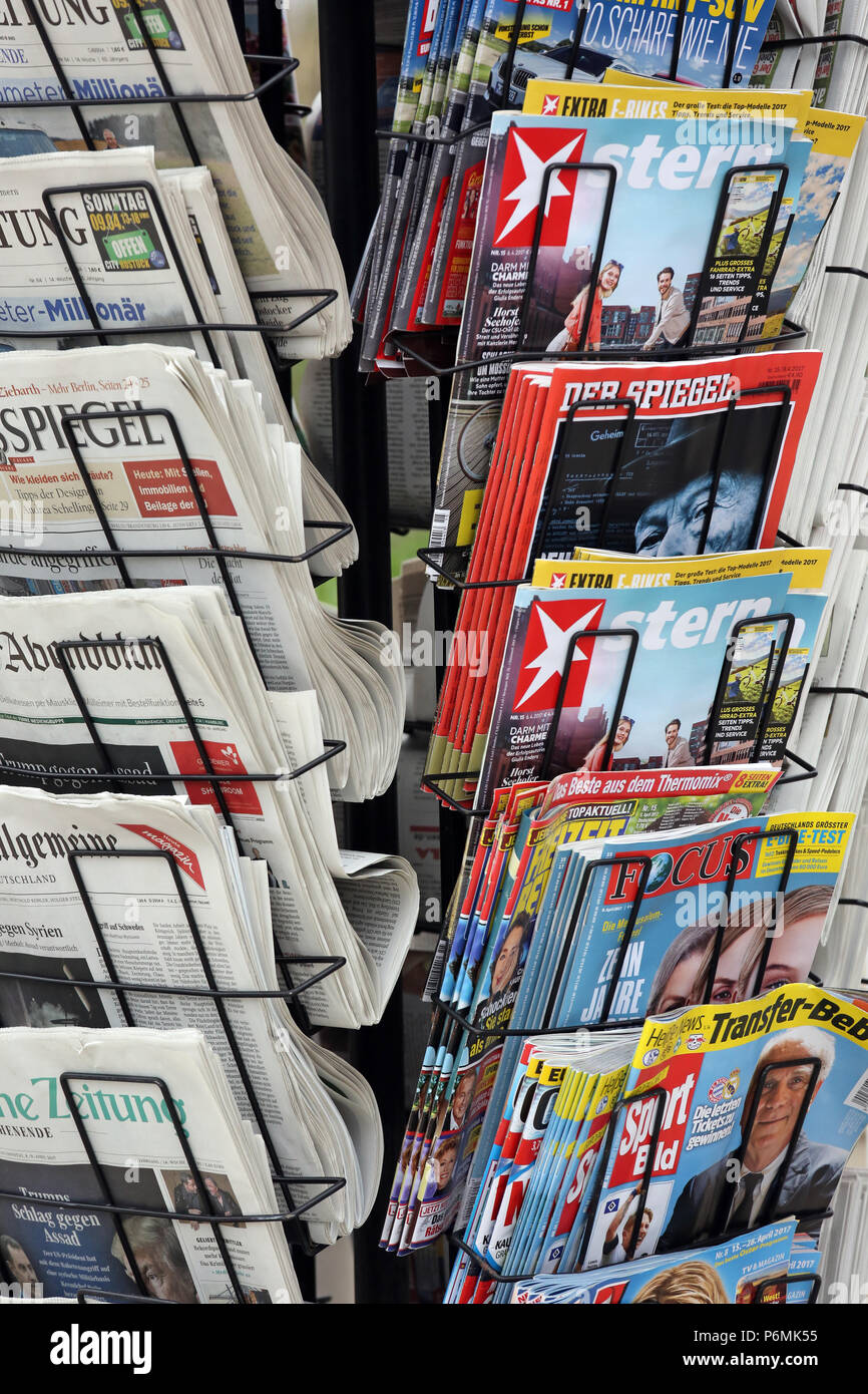 Warnemuende, daily newspapers and magazines in a newspaper stand Stock Photo