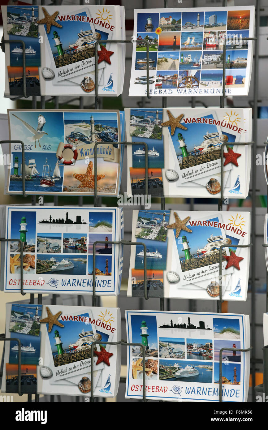 Warnemuende, postcards in a card stand - Stock Image