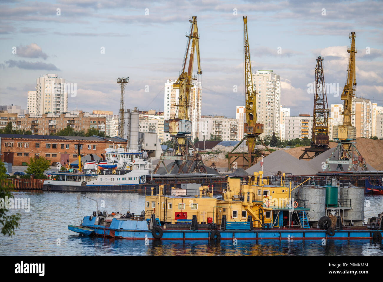 Loading and unloading of sand by crane. - Stock Image