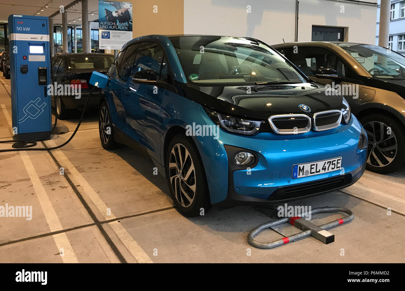 Berlin, electric car is charged - Stock Image
