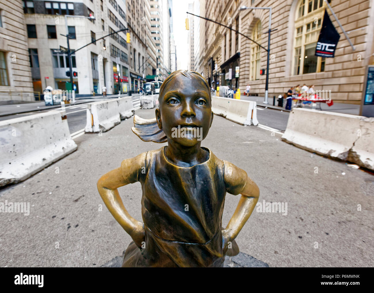 Fearless girl statue at its original location on wall street - Stock Image