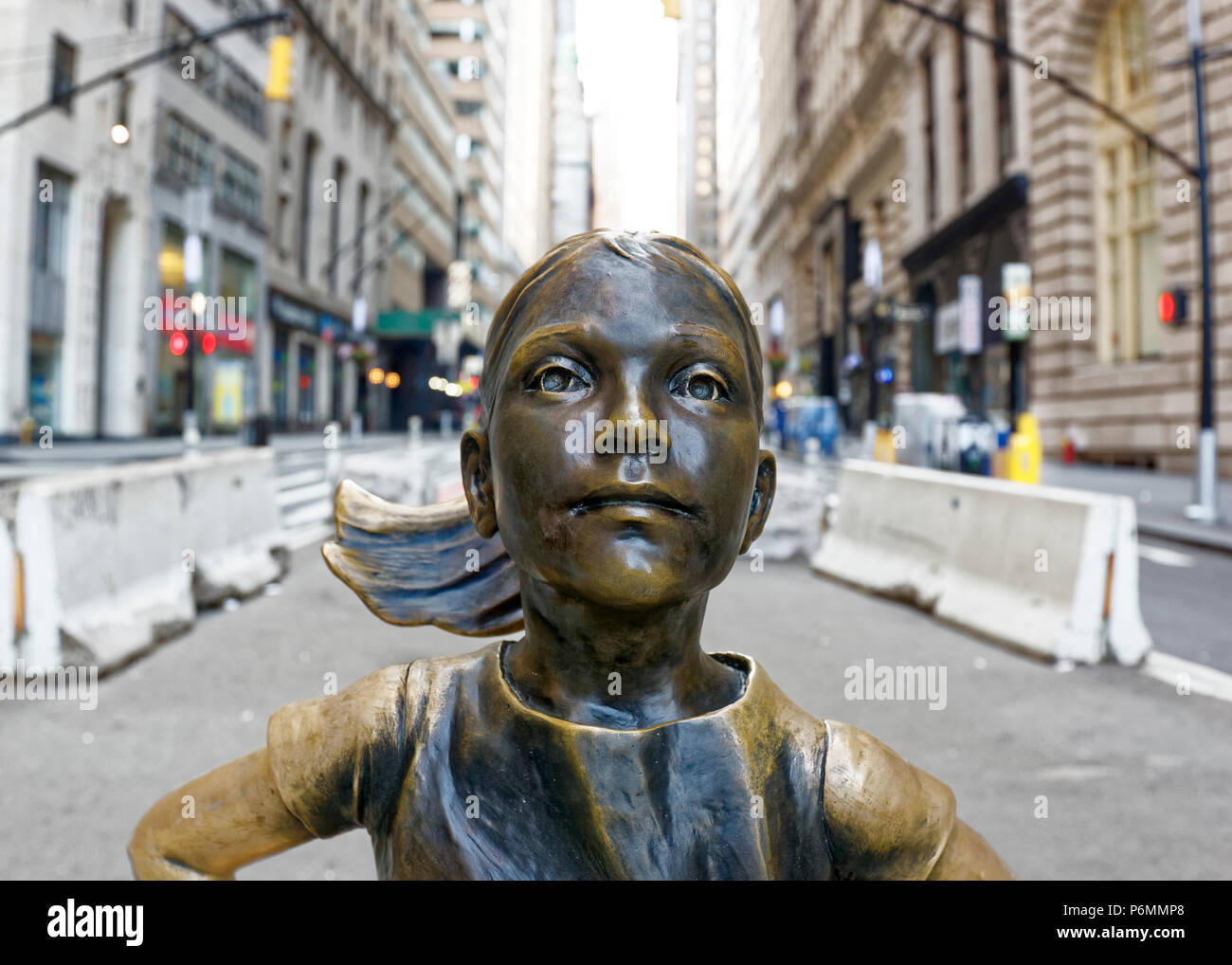 Fearless Girl statue on wall Street - Stock Image