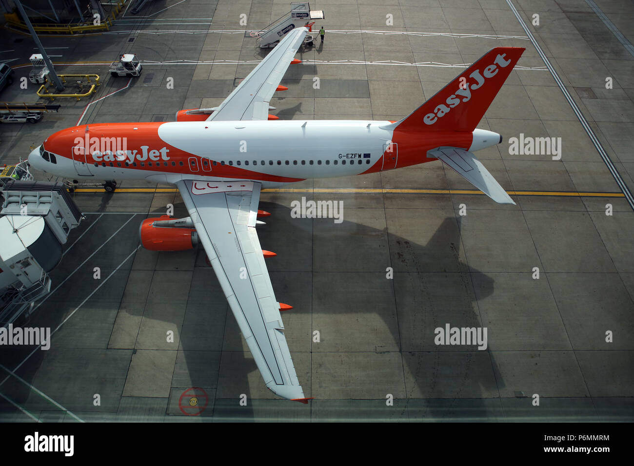 London, United Kingdom, Airbus A 319 owned by easyJet at the terminal of London Gatwick Airport - Stock Image