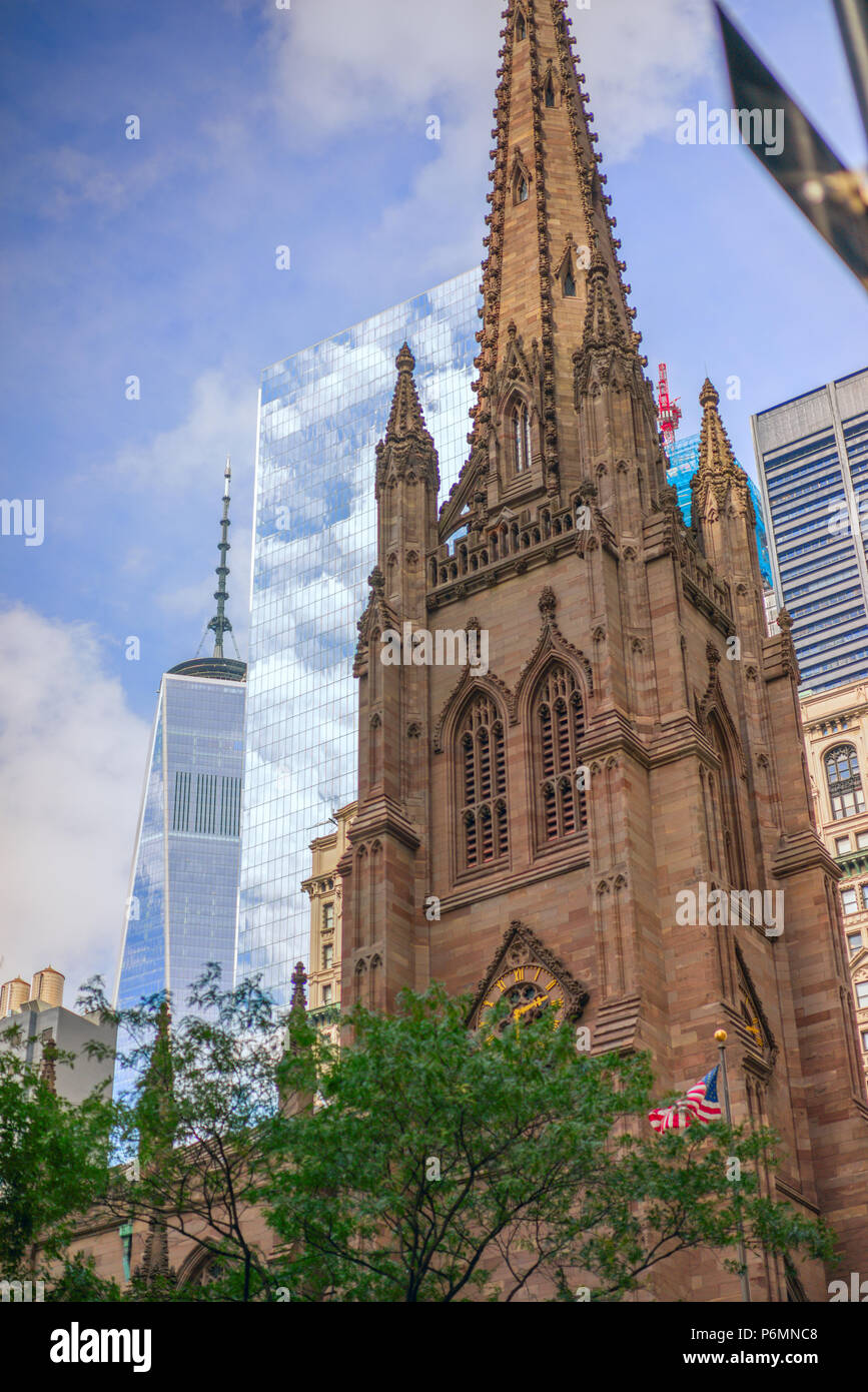 The different architectual styles of the ultra modern world trade centers and the old ornate Trnity Church add contrast to the New York cityscape - Stock Image