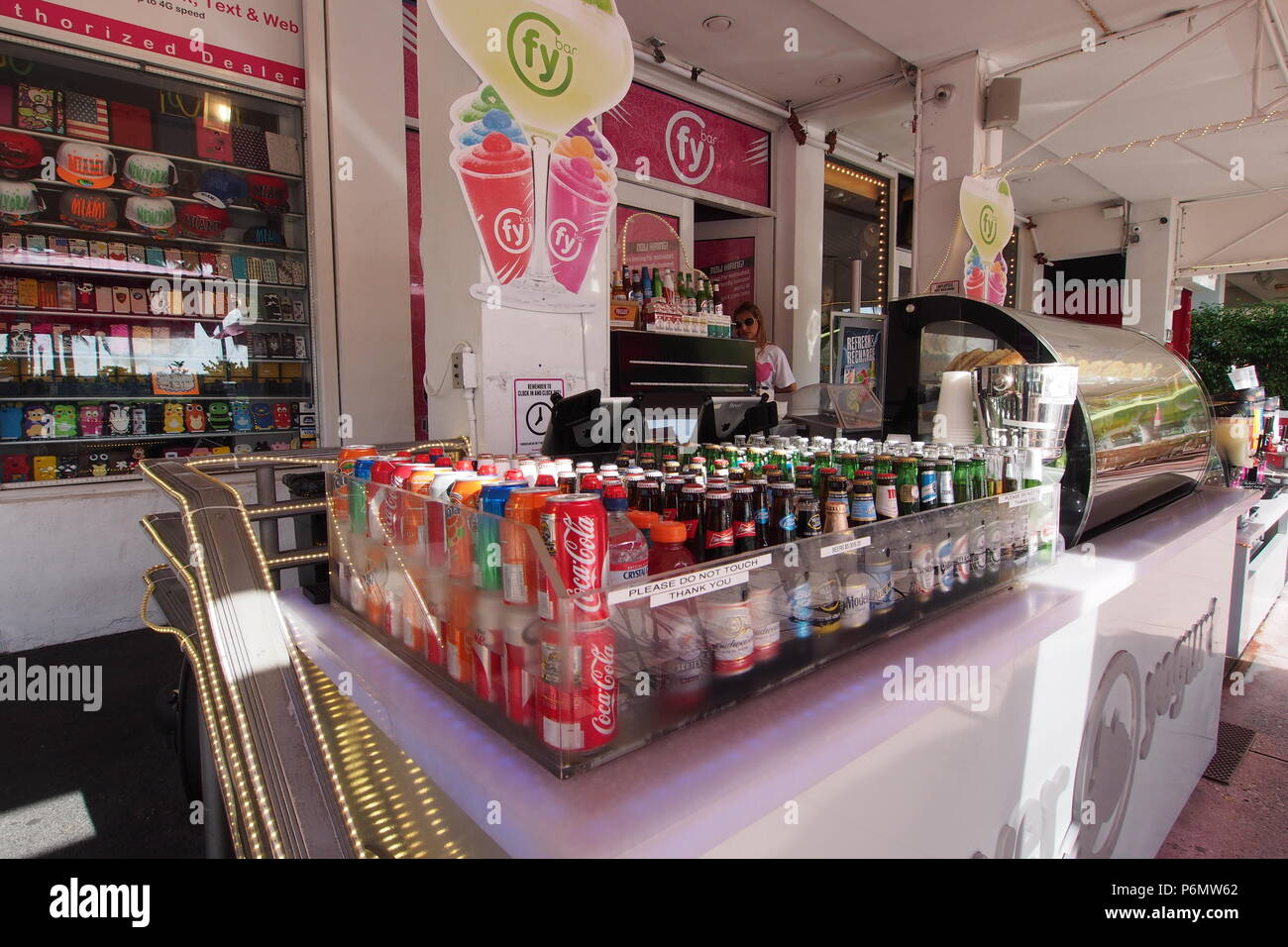 Sidewalk stall selling sodas, beer, pastries, etc. on Ocean Drive in Miami Beach, Florida, United States. - Stock Image