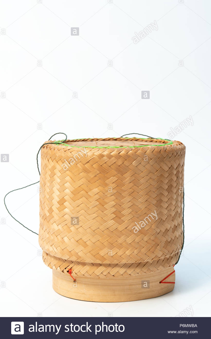 Bamboo box on a white background. Cooked rice is stored. - Stock Image